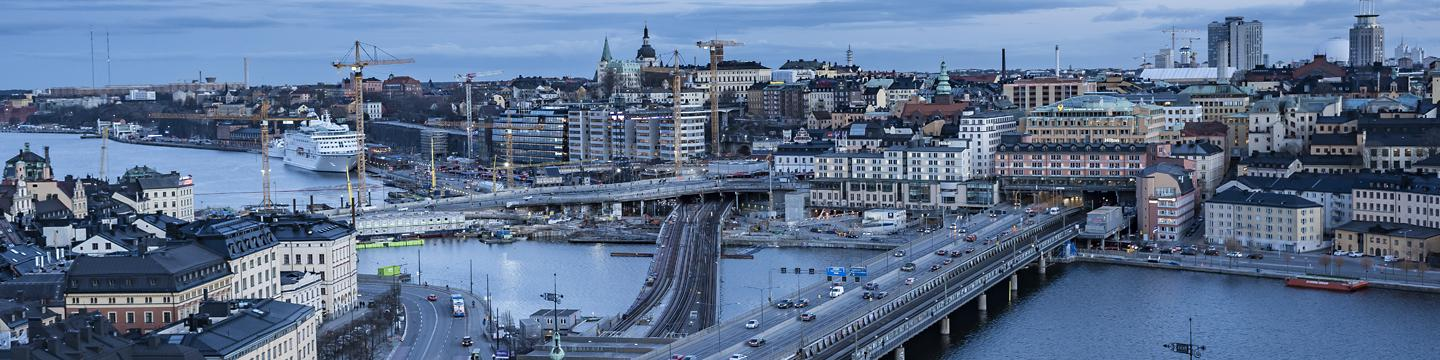 View over the city of Stockholm: buildings, water, bridges and tower cranes