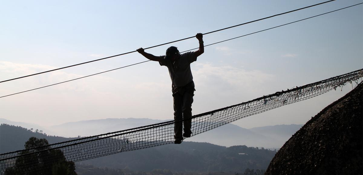 Man silhuette on radical bridge, occupational health and safety