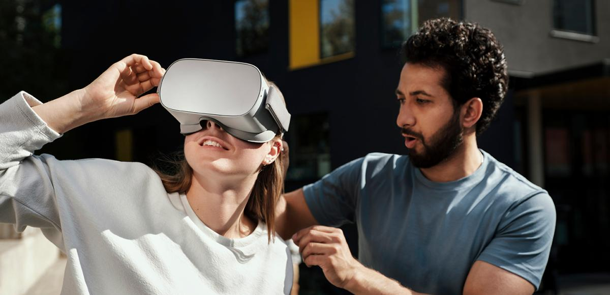 Man and woman trying VR set