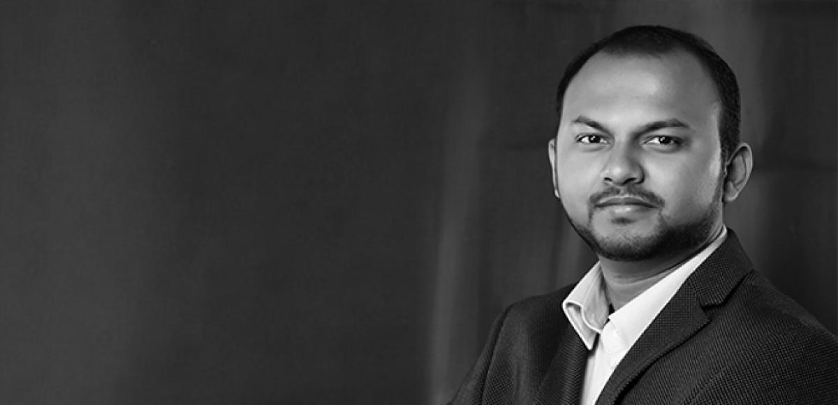 Black and white portrait of Prajit Datta