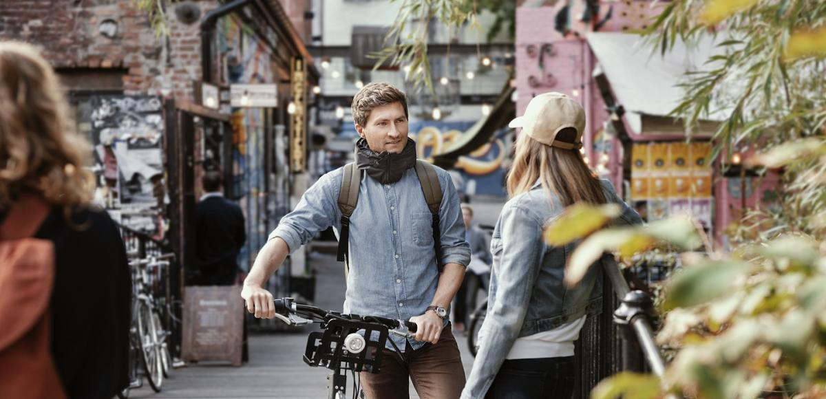 Man with a bike talking to a woman