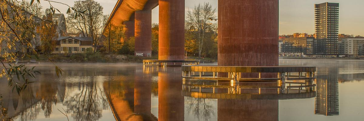 Reflection of a bridge on calm water