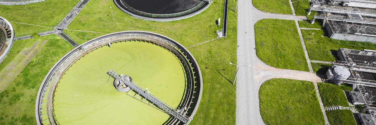 Sewage farm. Static aerial photo looking down onto the clarifying tanks and green grass.