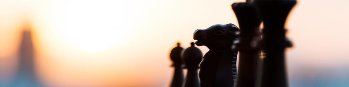 Black chess figures in a line
