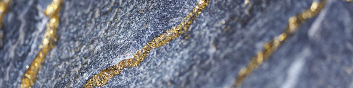 Gold encrusted grey rock