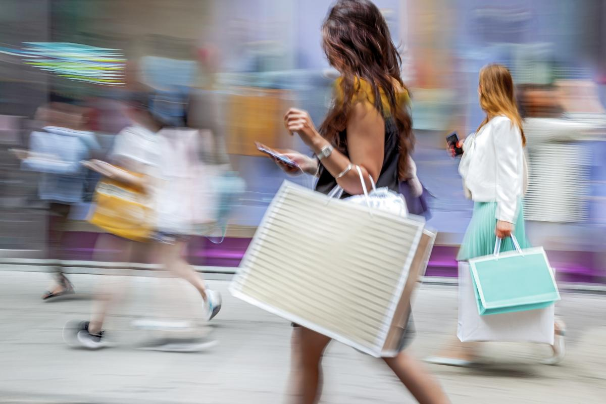 Shoppers with blurred background indicative of speed