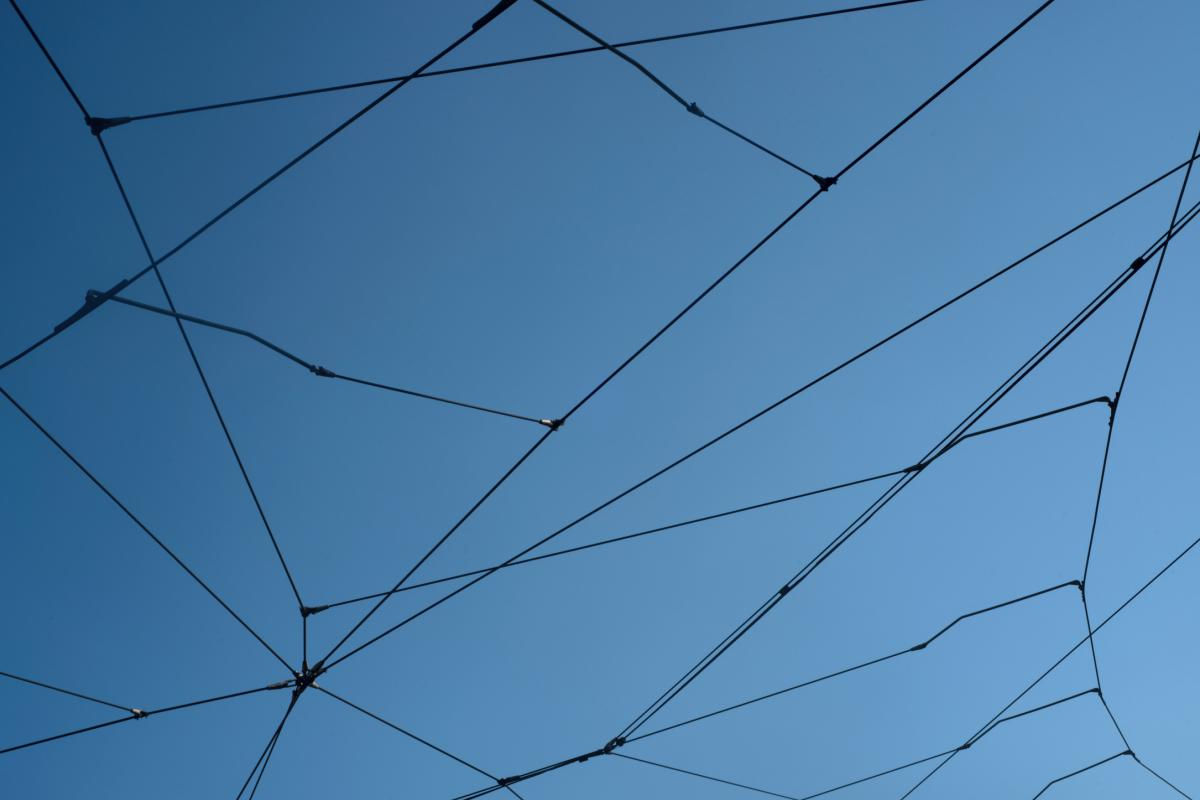 Transport power lines against a blue sky
