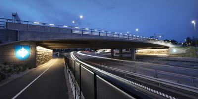 Motorway ramp and a bridge in the evening