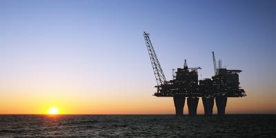 Oil and gas plant, sunset offshore platform
