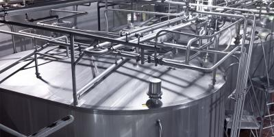 Stainless steel storage tanks at a dairy processing plant