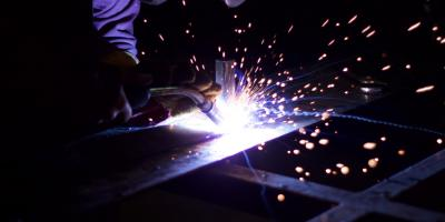 person welding  materials quality engineering