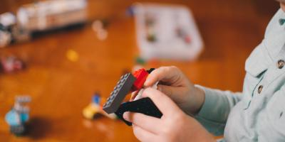 A child playing with lego.