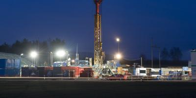 A groundwater drilling rig at night