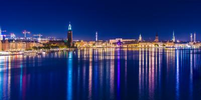Stockholm city lights at night with reflections in water