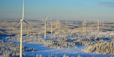 BJORKHOJDEN, SWEDEN - NOV 20, 2015: Bjorkhojden Wind Farm from height in the winter Swedish forest
