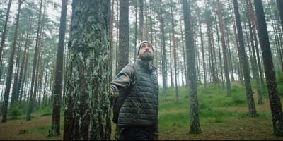 Man in forest light