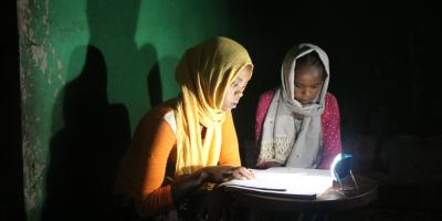 light bureau project in ethiopia women reading