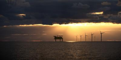 Wind farm on the north sea with sunset