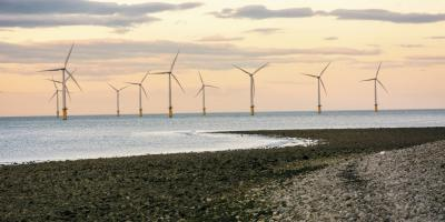 Offshore wind turbines in a sunset outside of the UK
