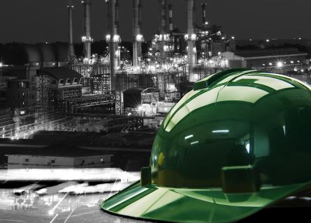 Hard hat on working table in oil refinery plant heavy petrochemical industry estate use for energy,power,fuel,gas and fossil petroleum topic