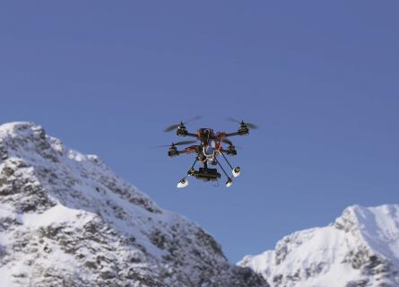 drone flying over mountain tops in the arctic