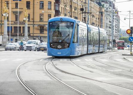 Tram approaching in a city street