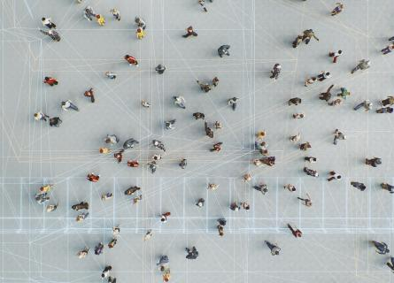 overview of a crowd in gray concrete