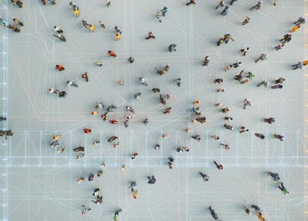 Drone perspective of a group of people connected through digital networks