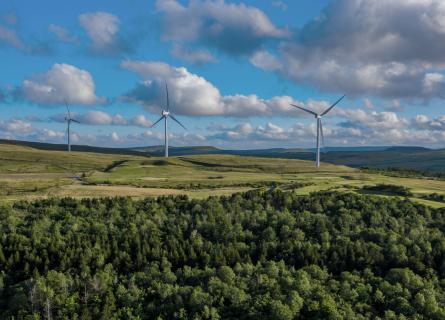 Aerial view of a small windfarm on a rural hillside in the South Wales Valleys, UK