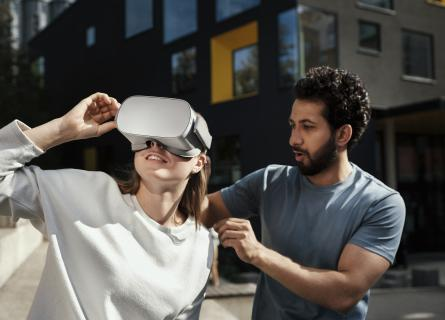 Woman and man trying on VR set