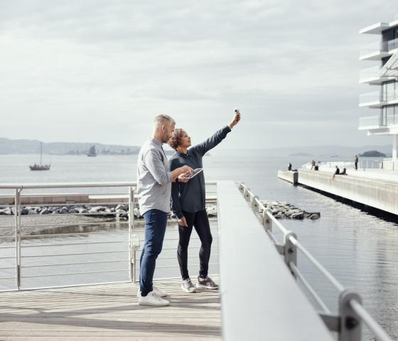 A woman and man standing on a pier