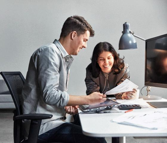 Man and woman at desk working