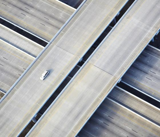 Aerial shot of one car on freeway