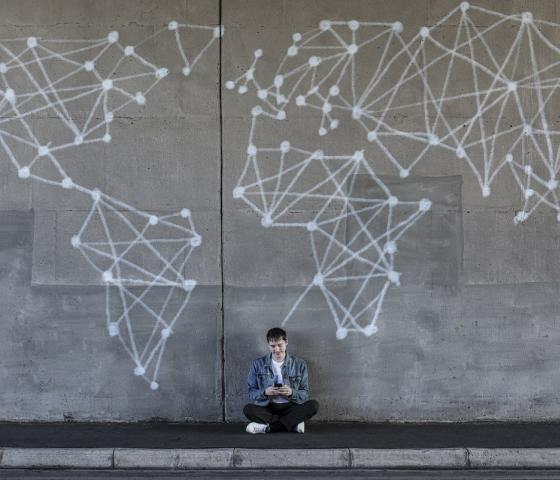 Man in front of a map on a wall