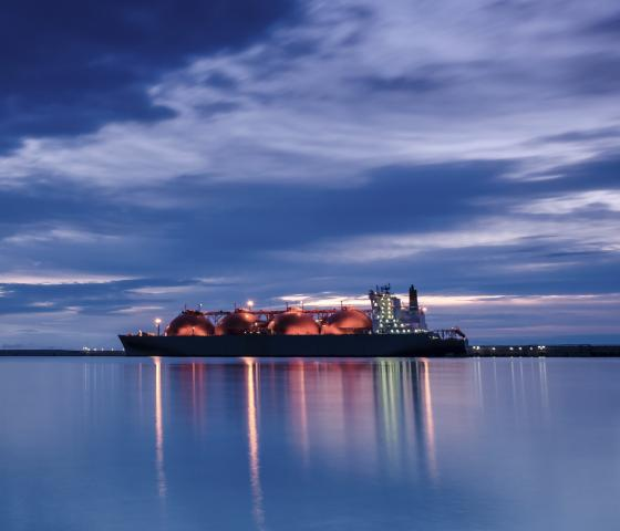 LNG tanker - sunrise over gas terminal